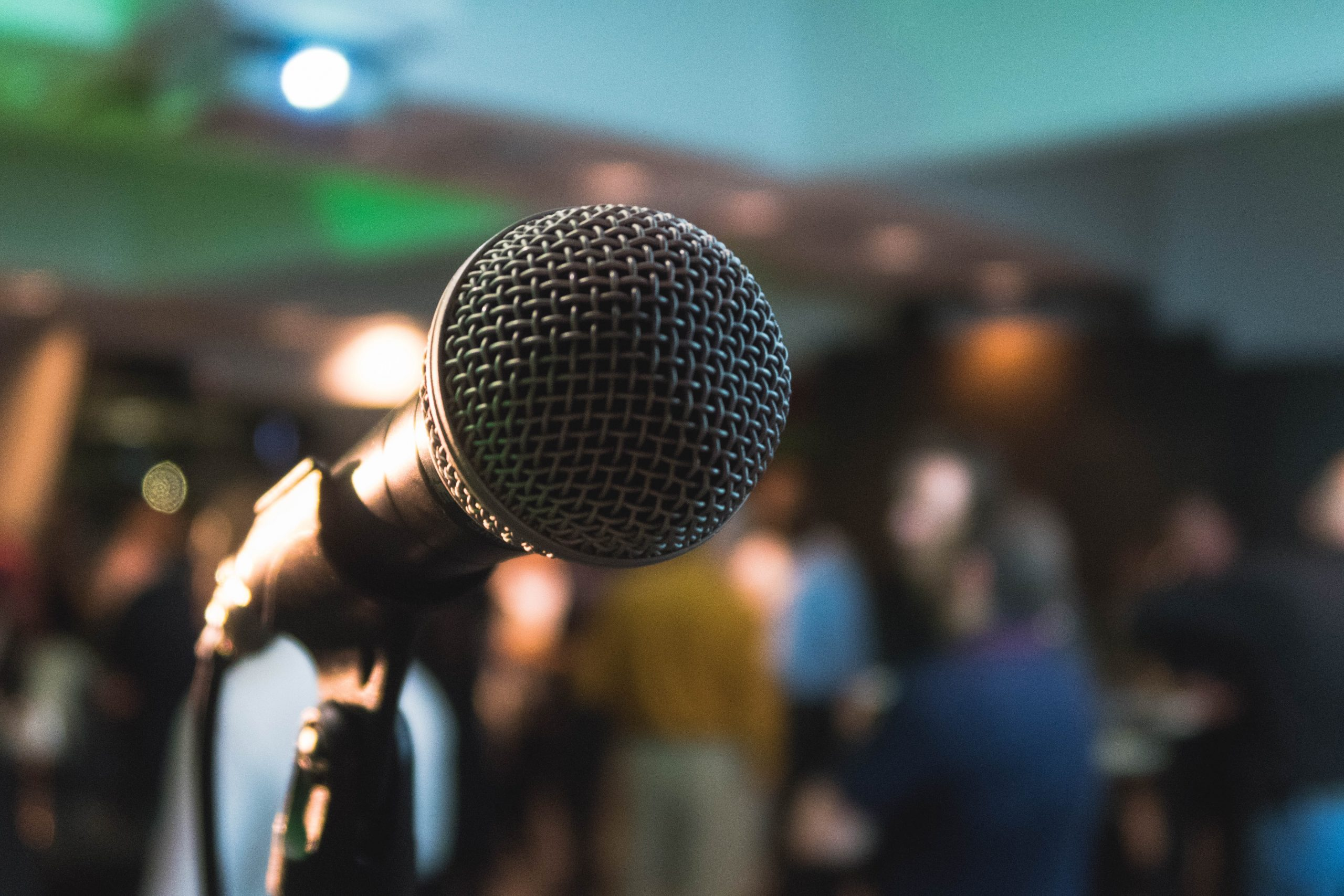 a microphone in front of a crowd of people